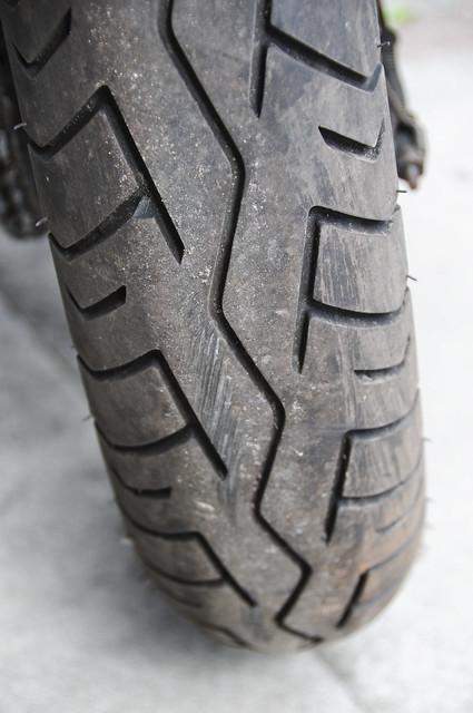 Suzuki TU250X Motorcycle, Motorbike, 2000 Model in Silver (rear tyre detail)