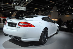 executive car(0.0), jaguar xf(0.0), convertible(0.0), automobile(1.0), automotive exterior(1.0), jaguar(1.0), wheel(1.0), vehicle(1.0), performance car(1.0), automotive design(1.0), auto show(1.0), bumper(1.0), jaguar xk(1.0), sedan(1.0), personal luxury car(1.0), land vehicle(1.0), luxury vehicle(1.0), coupã©(1.0), sports car(1.0),