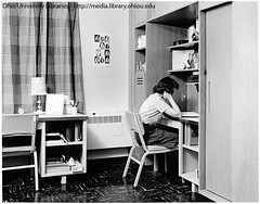 Ohio University Voigt Hall student studying at desk in dorm room, mid 1950s