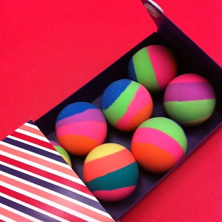 8 bouncy balls in a striped pencil case!