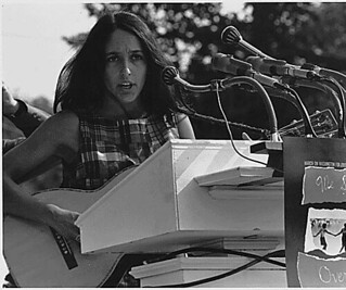 "Civil Rights March on Washington, D.C. [Entertainment: Vocalist Joan Baez. A sign hanging near the microphones reads ""We Shall Overcome."" ], 08/28/1963"