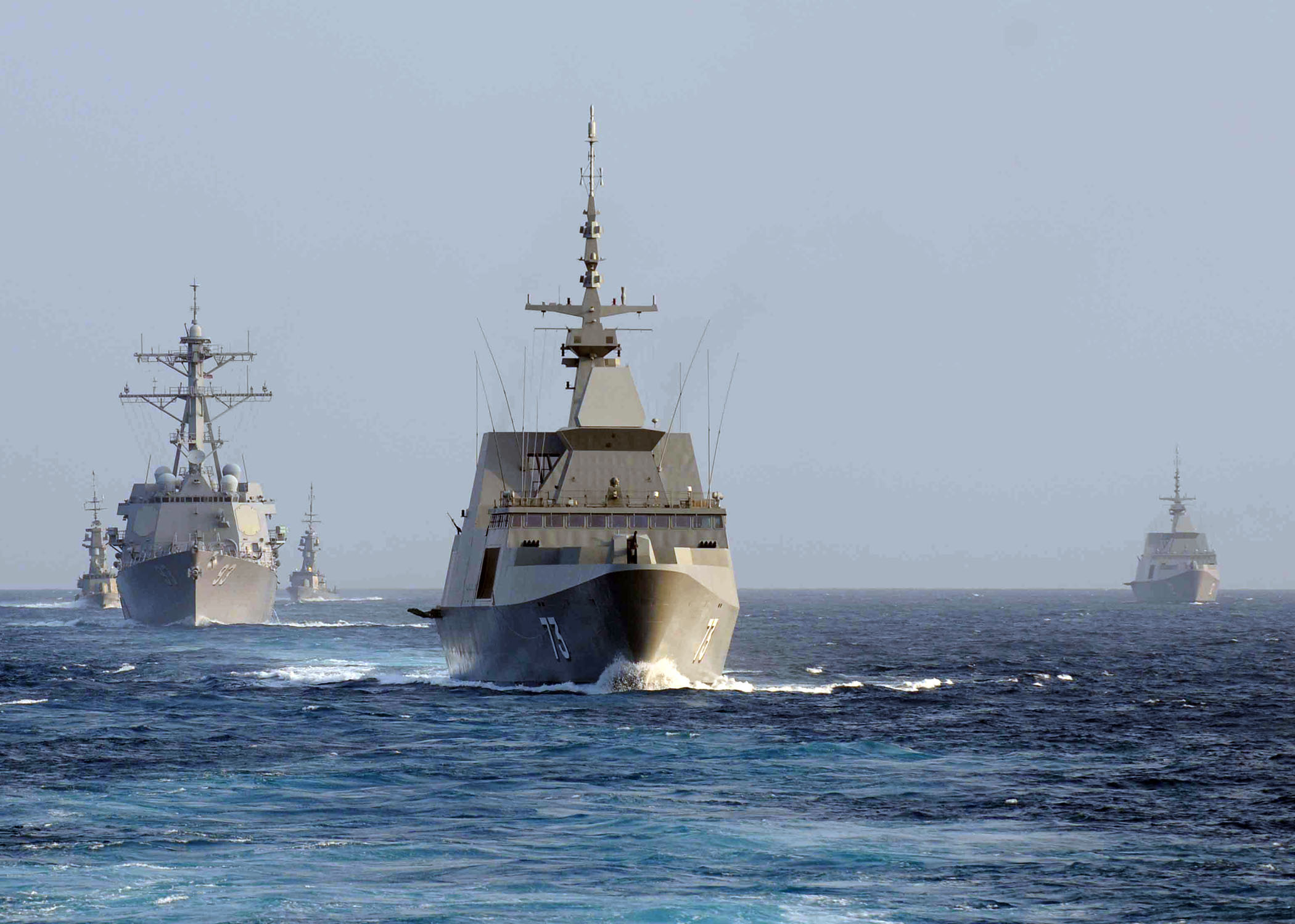 US and Singapore Navy ships transit South China Sea in formation