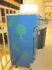 This compost station holds the bucket up off the floor keeping it more visible to students.