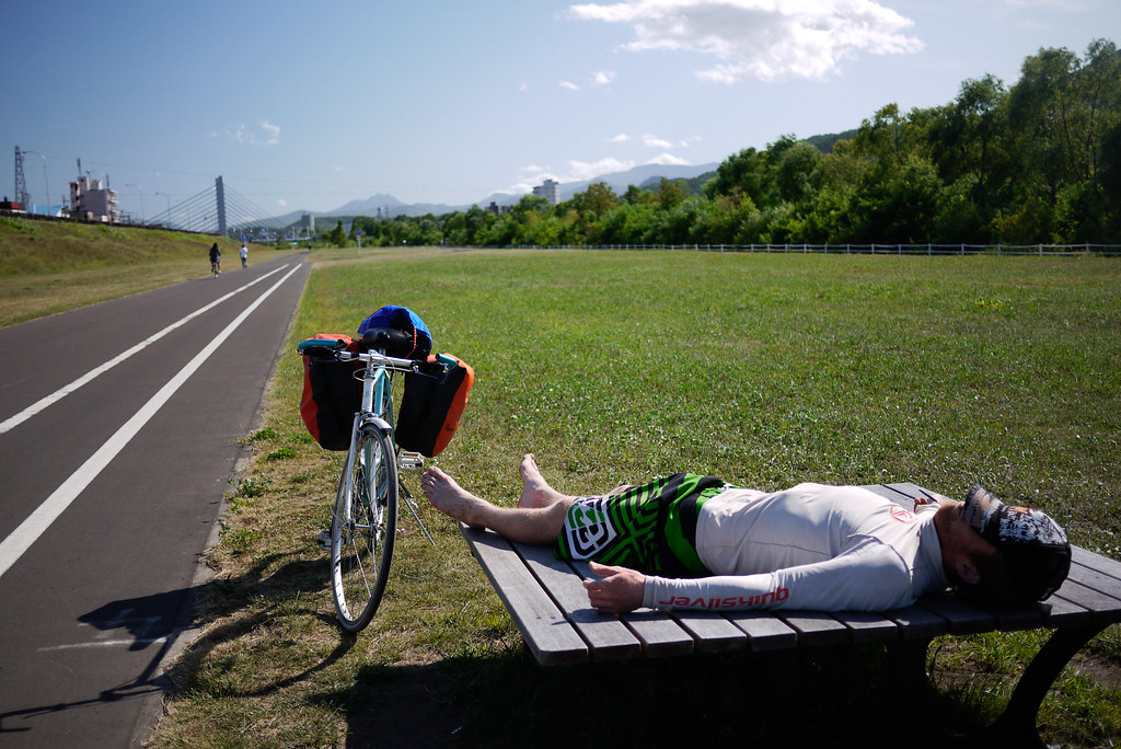 Cycling along the Toyohira River cycle path in Sapporo, Japan