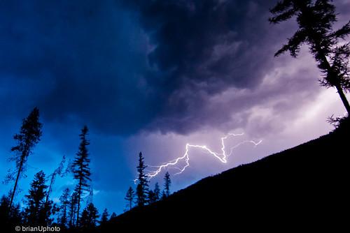 blue trees sky mountain storm water clouds shadows purple valley lightning puffy kootenays wispy lightningstrike stormydays goatriver travellingtheinteriorofbc