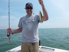 bass(0.0), big game fishing(0.0), fish(1.0), fishing(1.0), sea(1.0), recreation(1.0), casting fishing(1.0), outdoor recreation(1.0), jigging(1.0),