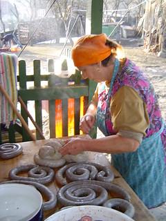 Preparing sausages after pig slaughter