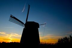 wind(0.0), machine(1.0), windmill(1.0), mill(1.0), silhouette(1.0), wind turbine(1.0), sky(1.0), dusk(1.0), sunset(1.0),