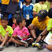 Sailor plays with students at the Wat Hua Yai School during a community service event. by Official U.S. Navy Imagery