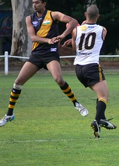 football(0.0), australian rules football(1.0), football player(1.0), sports(1.0), rugby league(1.0), rugby union(1.0), rugby football(1.0), rugby player(1.0), team sport(1.0), tackle(1.0), player(1.0), rugby sevens(1.0), ball game(1.0),