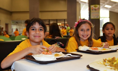 Children enjoy lunch freshly prepared and served on-site at the Inter Metro Summer Recreation Program in San Juan, Puerto Rico.