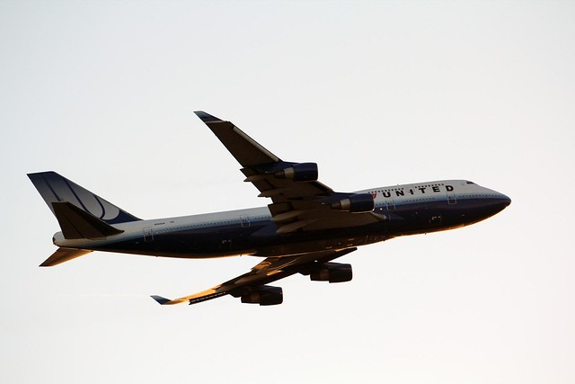 United Airlines plane flying overhead