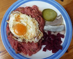 corned beef(0.0), produce(0.0), meatloaf(0.0), meal(1.0), lunch(1.0), breakfast(1.0), meat(1.0), steak tartare(1.0), food(1.0), full breakfast(1.0), dish(1.0), cuisine(1.0),