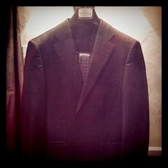 purple(0.0), tuxedo(0.0), pattern(1.0), textile(1.0), brown(1.0), clothing(1.0), blazer(1.0), maroon(1.0), outerwear(1.0), jacket(1.0), formal wear(1.0), suit(1.0),