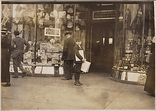 Photograph of Earle Frere, a young truant selling extra during school hours, 04/15/1912
