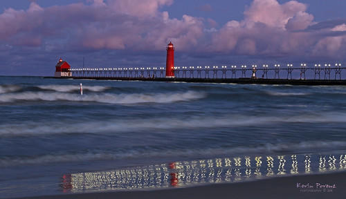 blue lighthouse lake reflection water clouds sunrise lights pier michigan wave august grandhaven