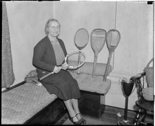 Mrs. Wightman with new and old racquets
