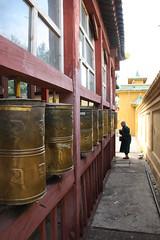 Prayer wheels around the temple