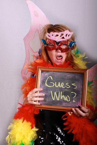 A great example of a wedding photo booth image with fancy dress and a chalkboard for guests to write on