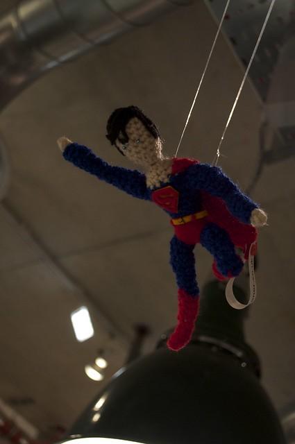 Superman flying above Gosh Comics till