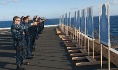 Sailors take aim at their targets.