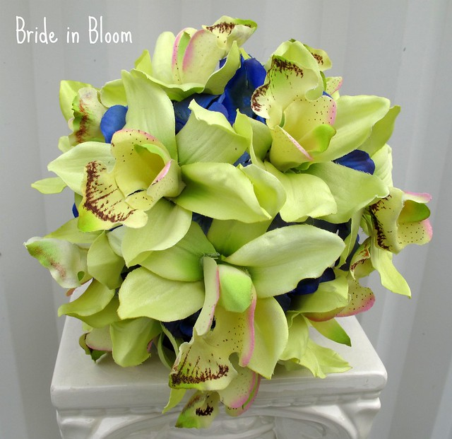 green orchid royal blue wedding bouquets