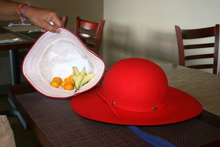 two hats with CalaMansi fruit