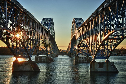 bridge blue light sky sun ny newyork reflection green water colors silhouette backlight sunrise river dark landscape island back buffalo arch steel south bridges twin grand upstate niagara western interstate backlit middle region 1962 190 1935 grandisland tonawanda truss thruway througharch