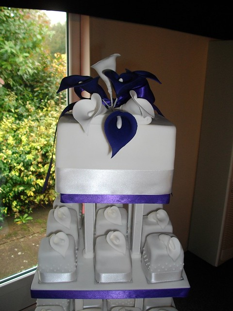 Purple wedding cake The top tier with deep purple and plain white Calla