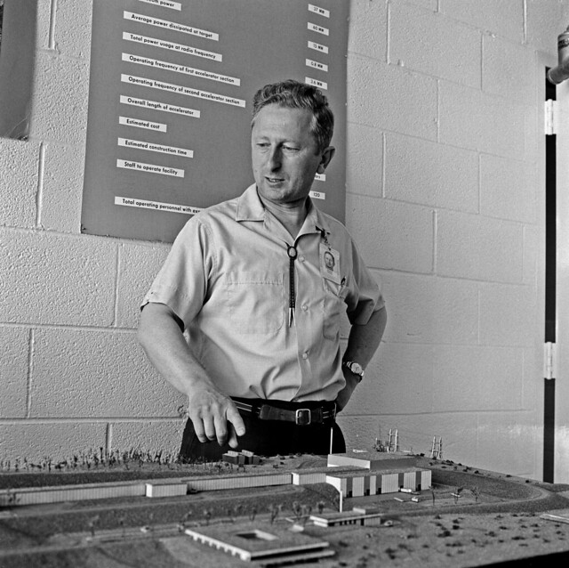 Louis Rosen, Laboratory Senior Fellow Emeritus, was instrumental in the  creation of the Los Alamos Neutron Science Center (LANSCE), directing the center until 1985. He points out a model of LANSCE's half-mile-long 800-MeV linear accelerator.