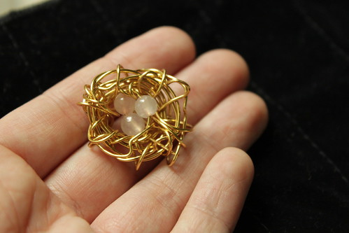 gold nest with pink beads