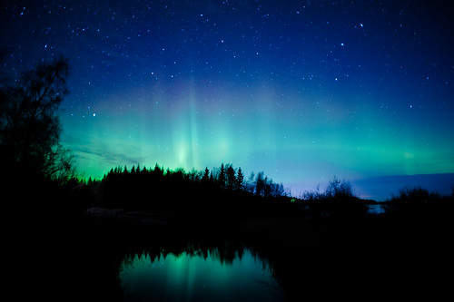Northern lights, stars, clouds and a creek
