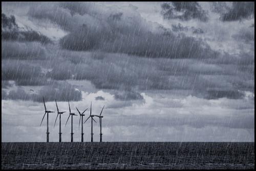 uk sea sky water windmill rain wales clouds experimental offshore gb windturbine prestatyn denbighshire sirddinbych fakerain canonef75300mmf456 pse8 photoshopelements8