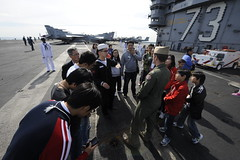 BUSAN, Republic of Korea (Oct. 2, 2011) Korean visitors tour the flight deck of aircraft carrier USS George Washington (CVN 73) during a public event in support of the Republic of Korea's Armed Forces Day. (U.S. Navy photo by Mass Communication Specialist Seaman William P. Gatlin)