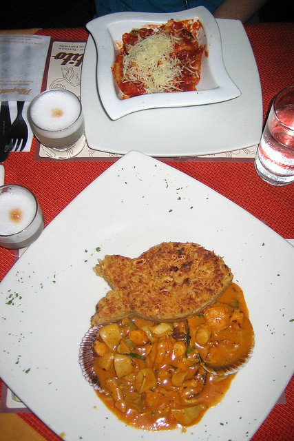 Tacu-tacu con mariscos and spinach ravioli
