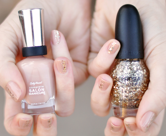 nude nails with chunky gold glitter stripe