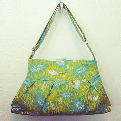 design(0.0), bag(1.0), art(1.0), shoulder bag(1.0), hobo bag(1.0), yellow(1.0), aqua(1.0), handbag(1.0), tote bag(1.0), turquoise(1.0),