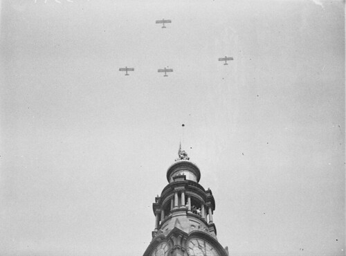 "Five Westland Wapitis of No 3 Squadron, RAAF, fly past the GPO clock which shows ""One-Minute's Silence"", Armistice Day, 11am, 11 November 1934 / photographer Sam Hood"