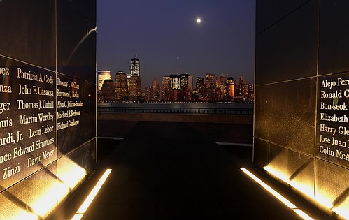 The New Jersey memorial to 9/11 victims. The end of the tunnel, where the names of the victims from the state are chisled, opens to a view of Manhattan and the Freedom Tower (the tall building left of center) rising from the site of the World Trade Center