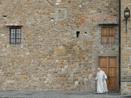 A monk on his way to sing Vespers