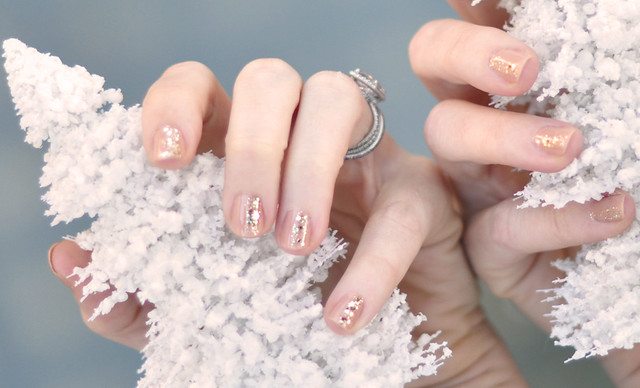 subtle glitter nails with   -white christmas trees