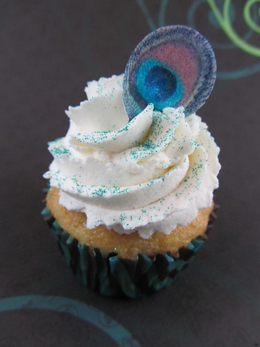 Banana Cream Pie Cupcake with Edible Peacock Feather and Jade Glitter