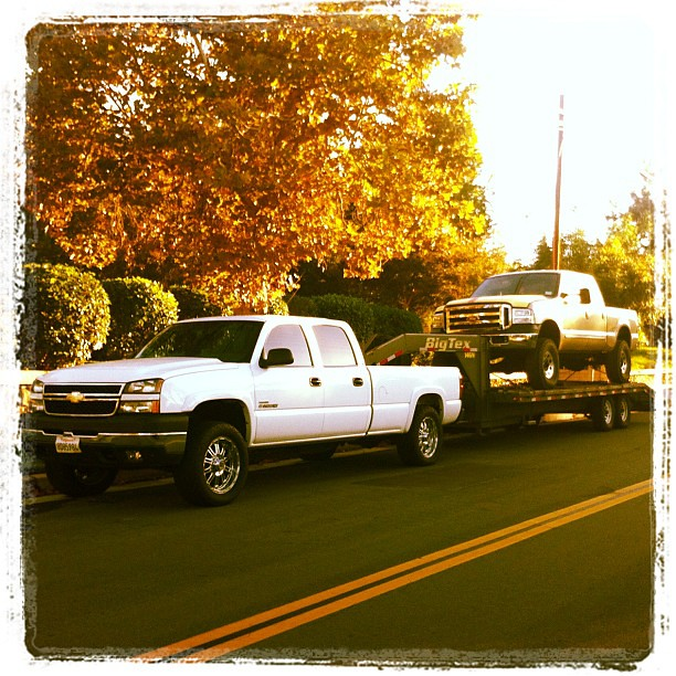 chevy towing a ford who would 39 ve thunk flickr photo. Black Bedroom Furniture Sets. Home Design Ideas