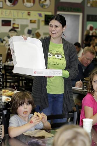 distributing doughnuts in lieu of birthday cake    MG 7664