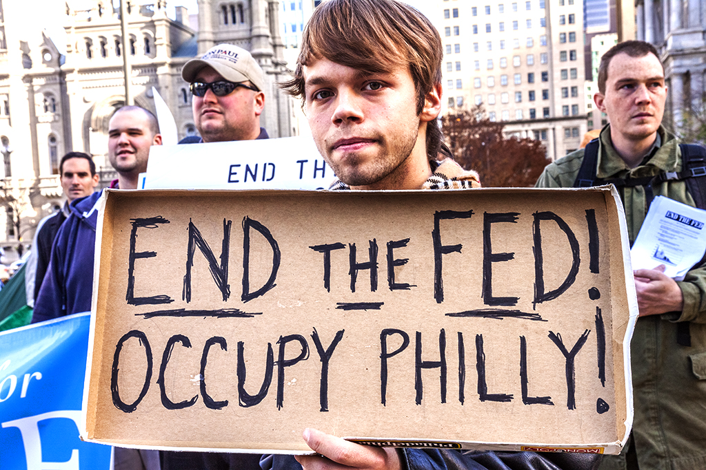 Young-man-with-END-THE-FED!-OCCUPY-PHILLY!-sign--Center-City
