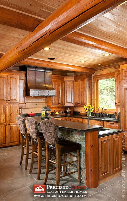 Beautiful custom log home kitchen by precisioncraft log for Custom luxury log homes