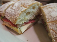 sandwich, meal, lunch, breakfast, ham and cheese sandwich, baked goods, muffuletta, ciabatta, food, dish, cuisine,