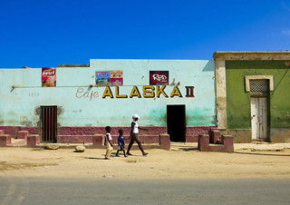 Woman Passing By A Cafe called Alaska, Namibe Town, Angola