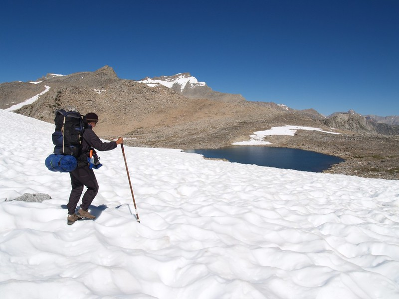 Backpacking across the snowfield near Bishop Pass