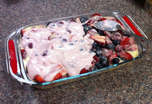 raspberry yoghurt on top of the custard-drowned berries